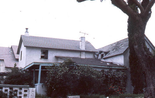 This slide is of the Corona residence located at 524 W.  7th Street.  It was taken during April 1985. - SLIDE CONDITION:  This slide is a little dark in areas and has been enhanced to  more clearly reveal color and structural details.