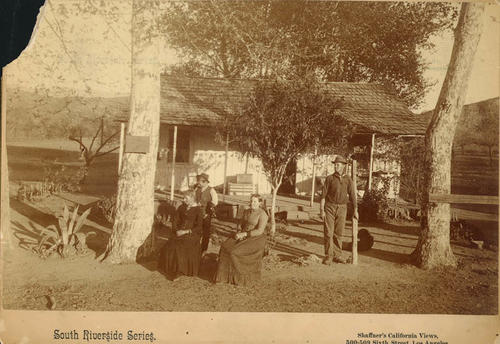 Photo of the McCarty residence with two women and two men in the front yard. The location was in Temescal Canyon.