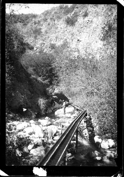 View of Cold Water Canyon.  Two men in photograph are unidentified.
