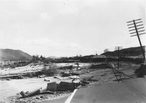 Damage done by floodwaters along the Santa Ana River.