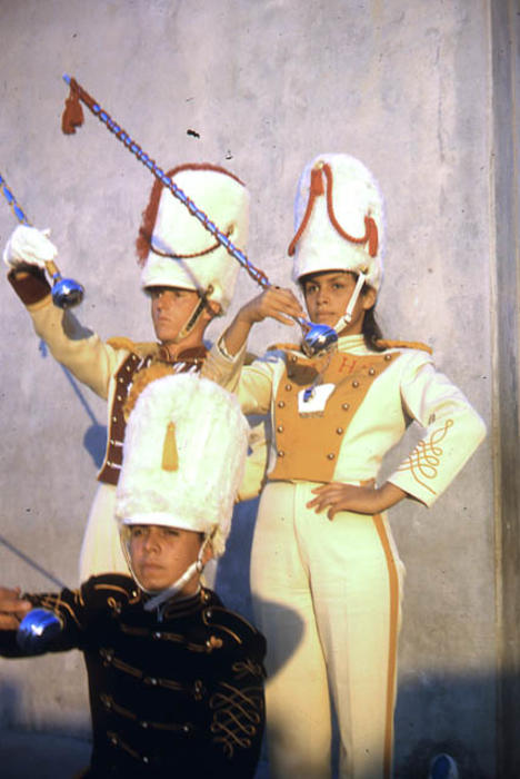 This slide is of a Band Jamboree, Corona Jr. High School, Drum Major and Majorette in full band uniform with another drum major kneeling in front.  SLIDE CONDITION:  Good.