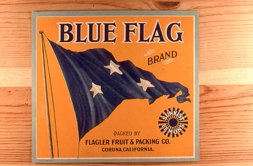 "This slide is of the ""Blue Flag"" brand citrus label. Packed by Flager Fruit and Packing Co. - Sunkist Lemons - Corona, California. - SLIDE CONDITION:  Good."