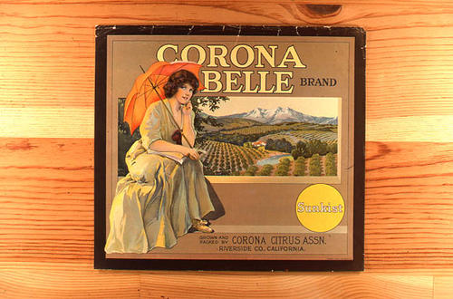 "This slide is of the ""Corona Belle"" brand citrus label.  The word Sunkist appears in a yellow circle on the label.  Product was grown and packed by the Corona Citrus Assn. Riverside County, California - SLIDE CONDITION:  Good."