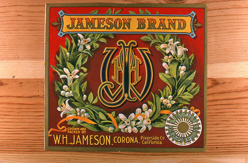 "This slide is of the ""Jameson"" brand.  This product is grown and packed by W. H. Jameson and depicts a monogram on the label. - Corona, Riverside Co., California. The Sunkist Oranges and Lemons logo is in the lower right hand corner. - SLIDE CONDITION:  Good."