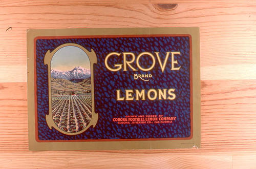 "This slide is of the ""Grove"" brand lemon citrus label.  This product is from the Corona foothill Lemon Company  - Grown and Packed at Corona, Riverside County, California.  - SLIDE CONDITION:  Good."