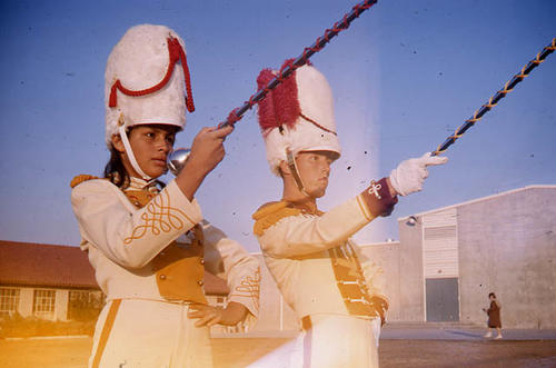 This slide is of a Band Jamboree, Corona Jr. High School, Drum Major and Majorette in full band uniform.  The is a front view with them standing on the field.  SLIDE CONDITION:  Fair, but light leak problems