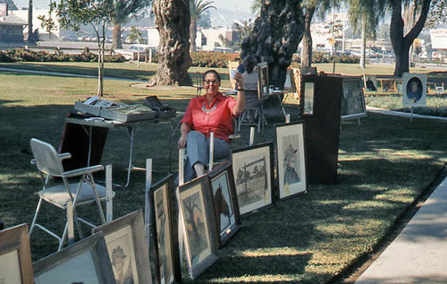 This slide is of a local artist in City Park. The name of this artist is unknown. If you recognize the subject of the picture, please call the Heritage Room of the Corona Public Library at 951.279.3593.  You may leave a voice mail message. SLIDE CONDITION:  Good.