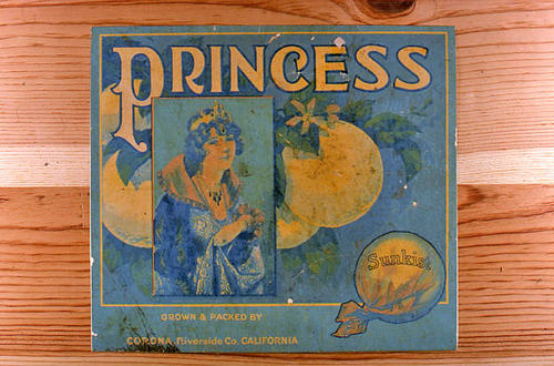 "This slide is of the ""Princess"" brand.  This product was grown and packed by an unnamed packing house and has a wrapped Sunkist orange on the label. - Corona, Riverside Co., California.  - SLIDE CONDITION:  Good."
