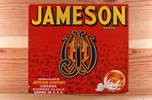 "This slide is of the ""Jameson"" brand.  This product is grown and packed by Jameson Company and depicts a monogram on the label. - Corona, Riverside Co., California.  A lemon rests on a Sunkist wrapper in the lower right hand corner. - SLIDE CONDITION:  Good."