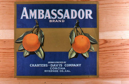 "This slide is of the ""Ambassador"" brand.  This product is grown and packed by Charters-Davis Company and depicts two oranges on the label. - Corona, Riverside Co., California.   - SLIDE CONDITION:  Good."