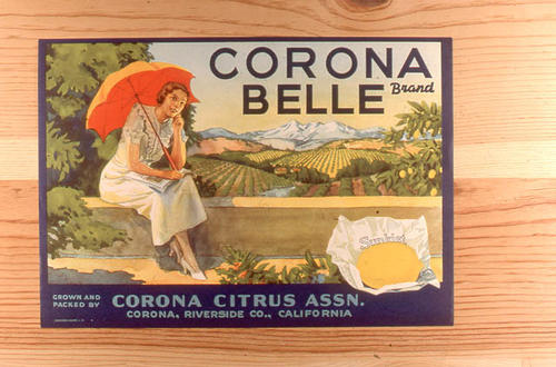 "This slide is of the ""Corona Belle"" brand citrus label. Grown and Packed by Corona Citrus Association - Lemons - Sunkist - Corona, California.  SLIDE CONDITION:  Good."