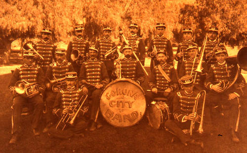 This slide is of a photograph of the early 1900's Corona City Band.  SLIDE CONDITION:  Good.  The film is deteriorating giving the picture a strong color cast. PRINT CALL No.  ART-cit-002a.