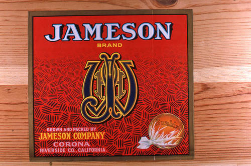 "This slide is of the ""Jameson"" brand.  This product is grown and packed by Jameson Company and depicts a monogram on the label. - Corona, Riverside Co., California.  An orange in the lower right hand corner has the Sunkist name. - SLIDE CONDITION:  Good."