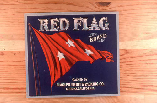 "This slide is of the ""Red Flag"" brand citrus label.  This product was packed by the Flagler Fruit and Packing Co. - Corona, California.  - SLIDE CONDITION:  Good."