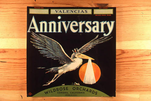 "This slide is of the ""Anniversary"" brand citrus label.  This orange product is from the Widrose Orchards - Corona, California - SLIDE CONDITION:  Good."