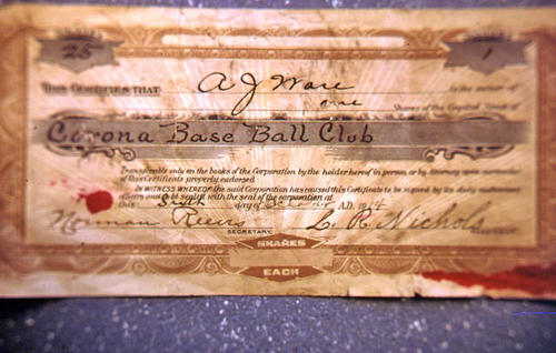 This slide is of a certificate for one share in the Corona Baseball Club.  The certificate was issued to  A. J. Ware on 10/06/1914.  SLIDE CONDITION:  The physical condition of the slide is good; however, the picture is not of good quality.