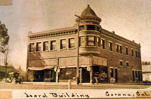 This slide is a photograph of the Daniel Lord Building located at 7th and Main Street in Corona. - SLIDE CONDITION:  Good