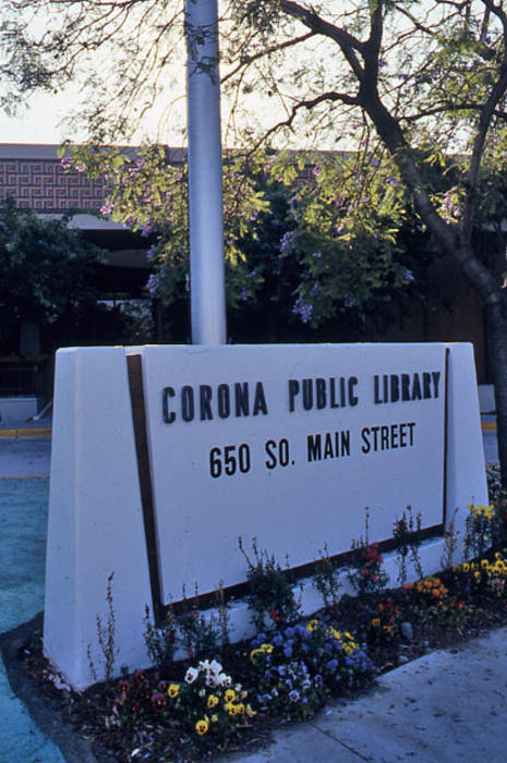 This slide is of the sign in front of the second Corona Public Library which was in operation 07/21/1971 - 08/08/1991. - SLIDE CONDITION:  Good