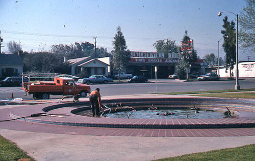 This slide shows repairs being done to the fountain at the Corona Civic Center February 1981.  At this time, the building functioned as the City Hall. - SLIDE CONDITION:  Good