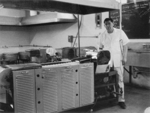 Onofre A. Ortiz in kitchen at Leon C. Ortiz and Sons Tortilla Store, located at North Main Street between 2nd and 3rd Streets.