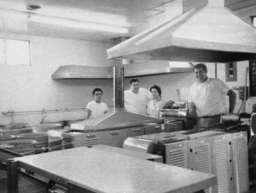 (from left) Gregory Ortiz, Onofre A. Ortiz, Delores Ortiz and Onofre A. Ortiz Jr, in kitchen of Leon C. Ortiz and Sons Tortilla Store located at North Main Street between 2nd and 3rd Streets.