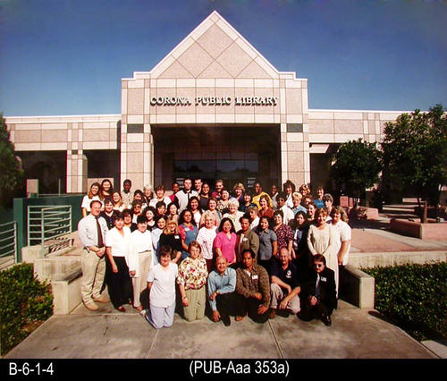 "This oversize photo is a group photo of the staff of the Corona Public Library.  - MEASUREMENTS: 16"" x 20"" - CONDITION:  This photo is in very good condition. Photo is kept in a Mylar sleeve. - COPIES:  1."