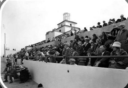 A view of the crowd gathered in the bleachers at the Club's outdoor swimming pool. The Lake Norconian Club was built by architect Dwight Gibbs for Rex B. Clark in 1928. It was constructed over 700 acres and featured a lake, Olympic sized swimming pools, hot mineral baths, and even an airfield. Ornate ballrooms, stately rooms and elegant art contributed to the $4 million price tag of the Club, which was designed for the rich and famous. Celebrities such as Walt Disney, Bob Hope, and Johnny Weismueller vacationed at the Norconian. After the Great Depression, the Club could not afford to stay open, and days before the start of the Second World War, the Navy purchased the land and turned it into a naval hospital, where many veterans went to recuperate after the war.