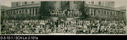 "This photograph is a picture of  the facualty and students at the second Lincoln School on 9th Street.  The small inset picture in the middle is a picture of the first grade.  MEASUREMENTS:  8"" X 36"" - CONDITION:  This picture is kept in a protectice sleeve.  There is a major full length crease going the height of the picture 10"" in from the right end. Copy 2:  101b is in excellent condition.  It does not have any creases or tears. - COPIES:  This is copy 2. Copy 2 is SCH-Lin 101b."