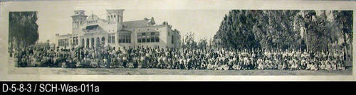 "This panoramic photograph is of the staff and student body of Washington Grammar School.  MEASUREMENTS:  8"" X 37 1/4"" - CONDITION:  This photograph is in a protective sleeve.  There is a 3"" crease on the left portion of the photograph coming up from the bottom border. - COPIES:  This is copy 1."