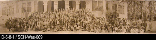 "This is a picture of the Washington School student body taken in front of the school.  MEASUREMENTS:  6 1/2"" X 33"" - CONDITION:  This photograph is in a protective sleeve.  On each end of the photo there is a small horizontal rip under one inch. Two small rips at the top of the picture.  The picture legibility is very good. - COPIES:  1."