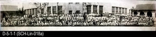 "1927-1928 Lincoln School student body photographed in front of the south wall of the school in the patio area.  MEASUREMENTS:  8"" X 45"" - CONDITION:  Good"