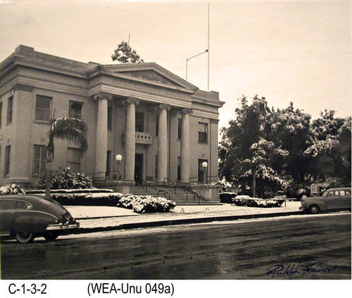 "This photo shows snow on the lawn and shrubs of the Corona City Hall.    MEASUREMENTS:  11"" x 14"" - CONDITION:  Very good - COPIES:  1."