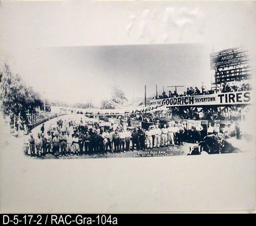 "This photograph is a copy of the original made by the Image Factory June 1985.  It shows the drivers and mechanics at the starting line.  MEASUREMENTS:  20"" X 24"" - Mounted on heavy matt board. - CONDITION:  Very Good - Copies:  1."