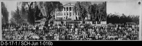 "This photograph of the facualty and students was taken in front of the school.  MEASUREMENTS:  8"" X 30"" - CONDITION:  This photograph is kept in a protective sleeve.  Several vertical creases upper right area and several in the lower left area.  Legibility of the photo is excellent. - COPIES:  This is copy 2."