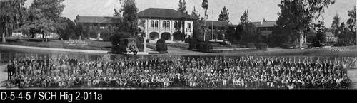 "This is a composite photo showing the Corona Sr. High School on 6th Street on the top portion of the picture and the Student Body on the bottom portion of the picture.  MEASUREMENTS:  8"" X 30"" - CONDITION:  The print legibility is excellent.  This photo is sealed in a Mylar envelope.  About 10"" from the left end there is a crease the runs the full height of the picture. - COPIES:  This is copy number 1."
