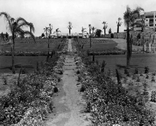 A view of the Club gardens during construction. The Lake Norconian Club was built by architect Dwight Gibbs for Rex B. Clark in 1928. It was constructed over 700 acres and featured a lake, Olympic sized swimming pools, hot mineral baths, and even an airfield. Ornate ballrooms, stately rooms and elegant art contributed to the $4 million price tag of the Club, which was designed for the rich and famous. Celebrities such as Walt Disney, Bob Hope, and Johnny Weismueller vacationed at the Norconian. After the Great Depression, the Club could not afford to stay open, and days before the start of the Second World War, the Navy purchased the land and turned it into a naval hospital, where many veterans went to recuperate after the war.