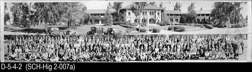 "This is a composite photo where the top half of the photo is a picture of Corona Sr. High School on 6th Street, and the bottom portion shows the Student Body as taken on March 24, 1938.  MEASUREMENTS:  8"" X 32"" - CONDITION:  This photo is kept in a Mylar envelope.  Creases on both the right and left ends of the photograph as well as other minor damage on the white edge portion of the photograph.  The legibility of the photograph is excellent. - COPIES:  This is copy number 1."