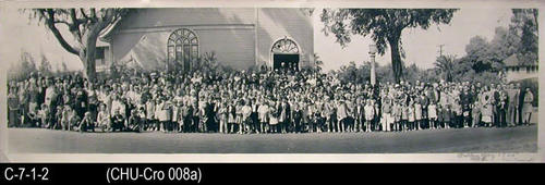 "This oversize photo shows the members of the First Christian Church out in front of the Church which was located at 9th and Main Streets.  Hollister B. Miller was the Pastor.  The event for the photograph was Ralley Day and there were 420 people present.  MEASUREMENTS:  8"" X 28"" - CONDITION: The bottom left corner is dog-eared.  The quality of the photograph is excellent.  There is writing in the lower right corner.  COPIES:  1."