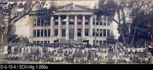 "This photograph is a picture of the entire student body in front of Corona High School One which was located on Main Street (west side) between Grand and Olive Streets.  MEASUREMENTS:  9 1/8"" X 23"" - CONDITION:  This photograph is in a protective sleeve.  The upper left corner is missing and the edges appear to have sustained possible silver fish damage. - COPIES:  This copy 1."