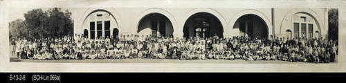 "This B/W photograph is a picture of the Lincoln School  student body taken in front of the school.  MEASUREMENTS:  8"" x 37 1/4"" - CONDITION:  There is a 4"" tear near the right end of the photograph. This photo is in a protective sleeve.  - COPIES:  1."