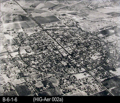 "This B/W glossy picture is an aerial photo of Grand Boulevard in Corona and a little of the sourrounding area.  A file reference states, ""National Geographic 1949"".  The photo appeared in the July 1949 National Geographic magazine on pages 100-101. A copy of the magazine is available in the Heritage Room, call number HR PAM 910.5 NAT- MEASUREMENTS: Framed:  23"" x 27"" and Print alone:  19"" x 23"" - CONDITION:  This photo is in very good condition. - COPIES:  1."