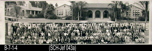 "This B/W photograph is of the Jefferson Elementary School and Student Body.  - MEASUREMENTS: 8"" x 27 1/2"" - CONDITION:  Very good.  This photograph is kept in a Mylar sleeve.  - COPIES:  Copy ""a"", indicates the first copy of the library's holdings of this photo.  NOTE:  This photo is the same as 43b which is a framed copy and is held as Artifact:  AAA.0785."