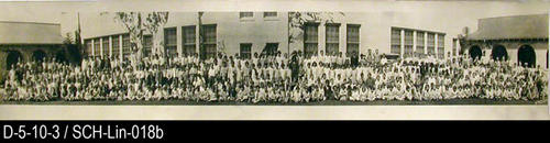 "This photo shows the student body of Lincoln  School behind the main building.  The school was located on 8th street between Howard and Victoria.  MEASUREMENTS:  8"" X 45"" - CONDITION:  This photo is kept in a protective sleeve. Due to the lengeth of this photo it has as some time been folded in half for storage thus leaving a vertical crease in the middle of the photo.  Otherwise this photo has excellent contrast and legibility. - COPIES:  This is copy 2."