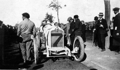 The man with the cap is Harry A. Miller, the race car and carburetor builder.  Eddie Rickenbacker in Peugeot #7 on Thanksgiving Day.