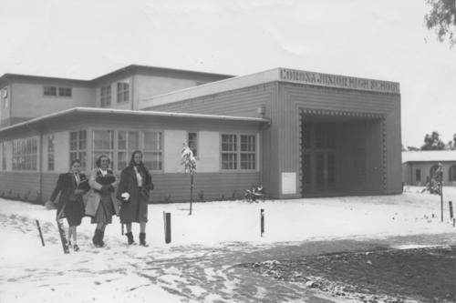The Big Freeze of 1949 - snowfall on the northwest corner of Main and Olive at Corona Junior High. Students are Judy Stevenson, Mary Lois Thome and Barbara Newcombe.