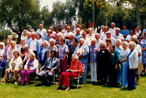 Group picture of people attending an Old Timer's Day Picnic. Corington, Ralph (holding hat), Bernice J. Todd (sitting), Lillia Kirkpatrick. First row (standing) second from left: Nera Amendson. Third from left: Mary Savage. Fourth from left: Gertude Hammond.