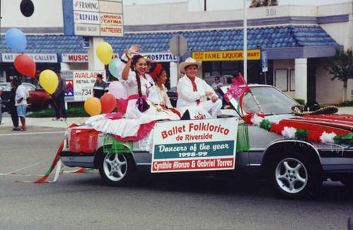 Ballet Folklorico parade car with their dancers of the year: Cynthia Alonzo and Gabriel Torres.