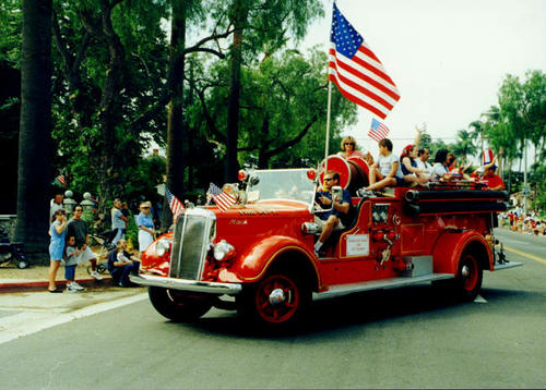 A fire truck on the parade route for Fourth of July.