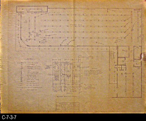 "This blueprint is the electrical plan for the market.  MEASUREMENTS:  30"" X 38"" - CONDITION:  C-7-3-7 is in good condition with the exception of the browing of the paper.  C-7-3-7b shows some wear and tear but  is in a better overall condition.  A  2"" tear is starting from the right side.  Water damaged is also in the right side area.  The paper on both copies is taking on a brownish tone. - COPIES:  2"