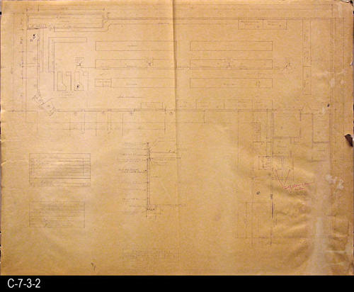 "This blueprint is the floor plan for the market.  It also has the following schedules:  Door, Window, Heating and Cooling. MEASUREMENTS:  30"" X 38"" - CONDITION:  C-7-3-2 shows wear and tear and there is an area about 5"" starting at the right edge that is water damaged.  There is also a 1"" tear going in from the right edge.  C-7-3-2b shows some wear and tear but does not have the right edge water damage.  It is in a better overall condition.  Both copies are legible but are beginning to fade. The paper is taking on a brownish tone. - COPIES:  2"
